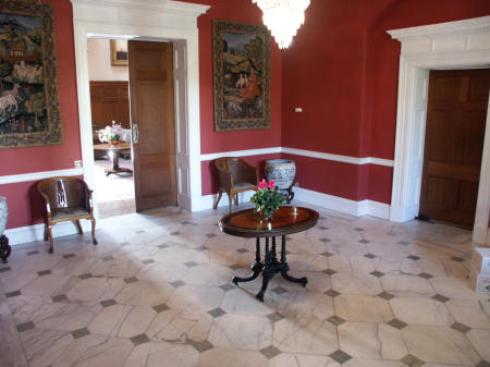 Entrance Hall. Painted red for a film. We liked it so left it red.